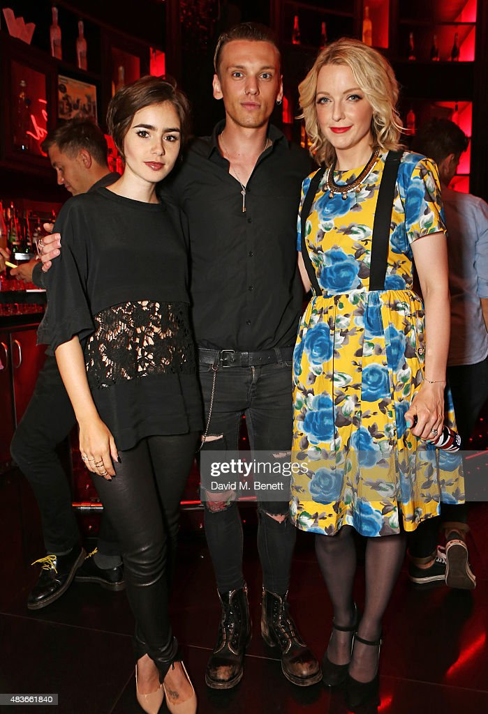 Lily Collins Jamie Campbell Bower and Lauren Laverne attend the launch of W London Leicester Square's Britpop Vinyl Collection curated by DJ Lauren...