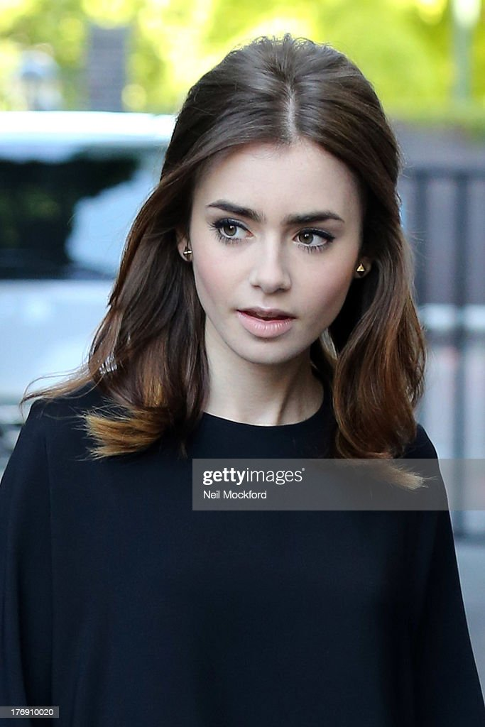 <a gi-track='captionPersonalityLinkClicked' href=/galleries/search?phrase=Lily+Collins&family=editorial&specificpeople=3520243 ng-click='$event.stopPropagation()'>Lily Collins</a> seen at the ITV Studios on August 19, 2013 in London, England.