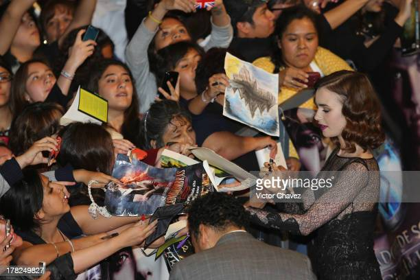 Lily Collins signs autographs to fans during The Mortal Instruments City of Bones' Mexico City screening at Auditorio Nacional on August 27 2013 in...