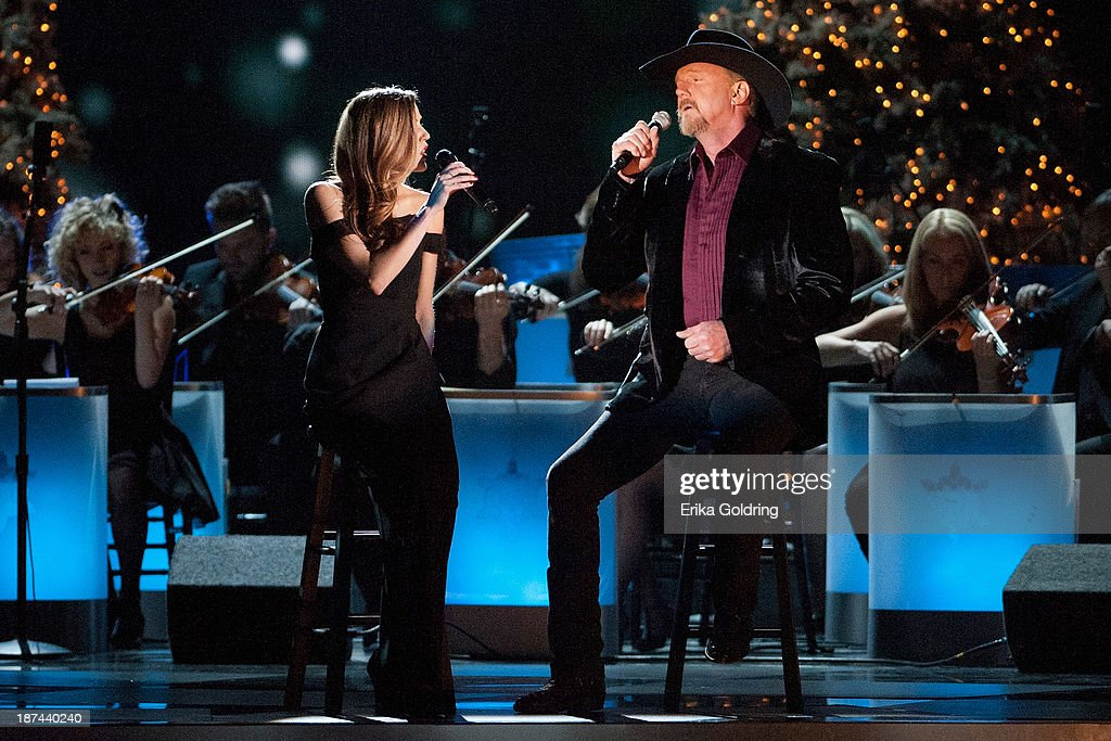 Lily Costner and <a gi-track='captionPersonalityLinkClicked' href=/galleries/search?phrase=Trace+Adkins&family=editorial&specificpeople=224686 ng-click='$event.stopPropagation()'>Trace Adkins</a> perform during the CMA 2013 Country Christmas on November 8, 2013 in Nashville, Tennessee.