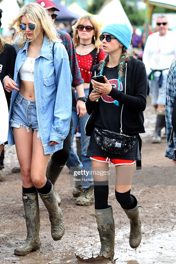 Lily Donaldson and Cara Delevigne attend the Glastonbury Festival at Worthy Farm, Pilton on June 25, 2016 in Glastonbury, England.