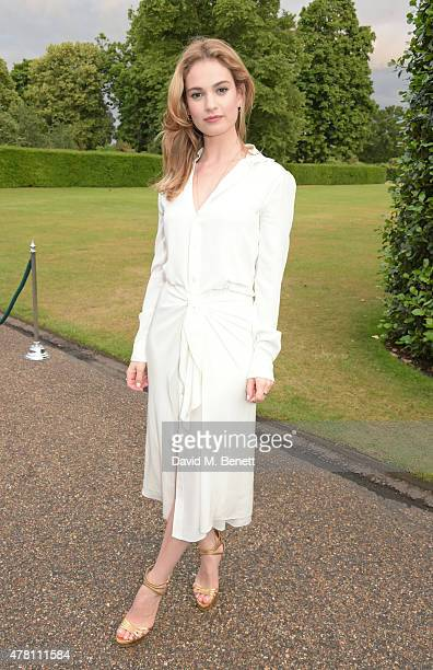 Lily James attends The Ralph Lauren Vogue Wimbledon Summer Cocktail Party hosted by Alexandra Shulman and Boris Becker at The Orangery at Kensington...