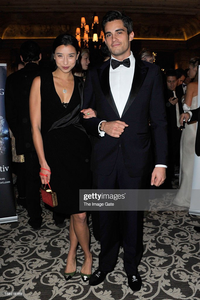 Lily Kwong and Orazio Rispo attend the ASMALLWORLD Gala Dinner for Alzheimer Society at the Gstaad Palace Hotel on December 15, 2012 in Gstaad, Switzerland.