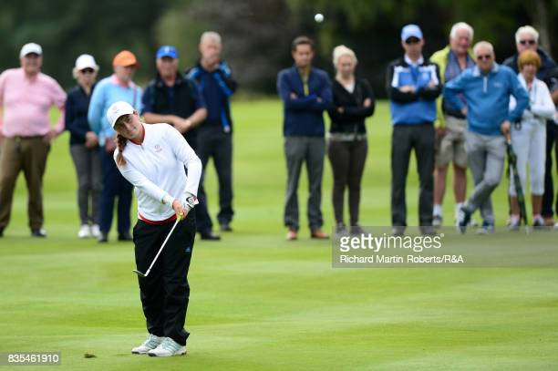 Lily May Humphreys of England chips to the 18th green during her semifinal match against Paula Kimer of Germany during the Girls' British Open...