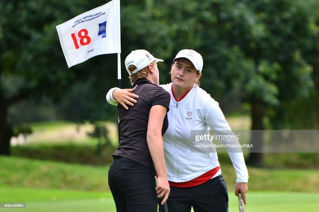 Lily May Humphreys of England (R) embraces Paula Kimer of Germany after winning her semi-final match during the Girls' British Open Amateur Championship at Enville Golf Club on August 19, 2017 in Stourbridge, England.