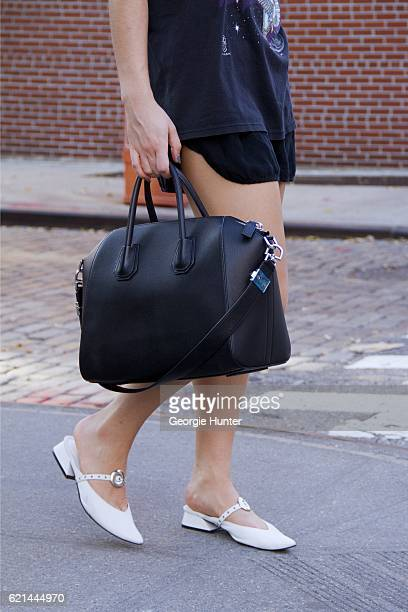 Lily Montasser wearing black oversized vintage cotton HarleyDavidson rock tee with print Yuul Yie white leather slides sandals with low heel strap...