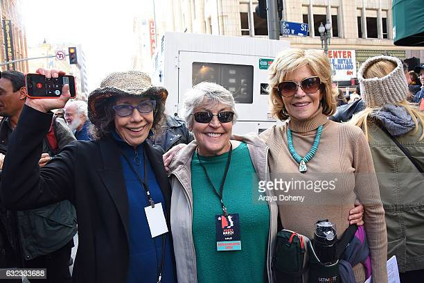 Lily Tomlin guest and Jane Fonda attend the Women's March Los Angeles on January 21 2017 in Los Angeles California