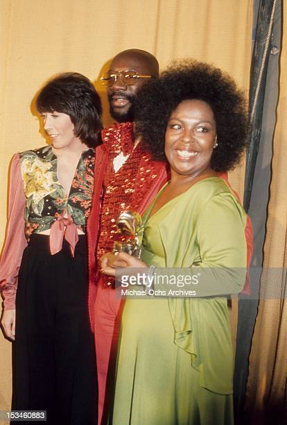 Lily Tomlin Isaac Hayes and Roberta Flack winner of Album of the Year for 'Killing me Softly With His Song' pose backstage at the 16th Annual Grammy...