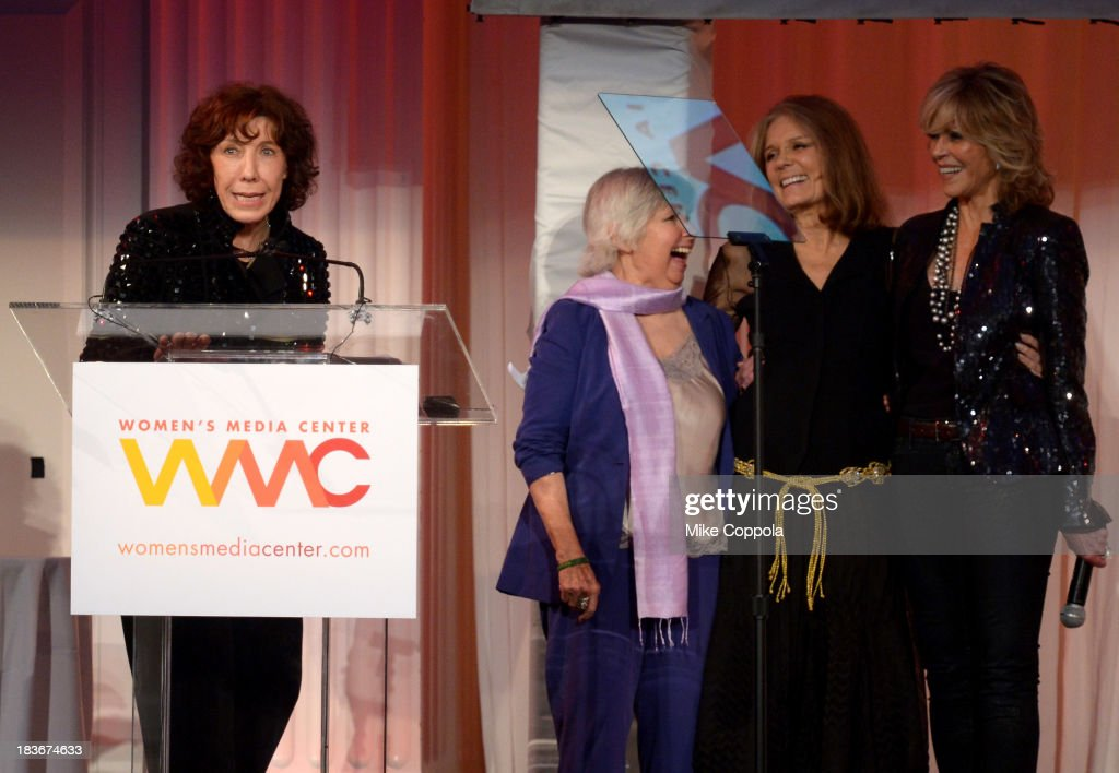 <a gi-track='captionPersonalityLinkClicked' href=/galleries/search?phrase=Lily+Tomlin&family=editorial&specificpeople=208236 ng-click='$event.stopPropagation()'>Lily Tomlin</a>, Robin Morgan, <a gi-track='captionPersonalityLinkClicked' href=/galleries/search?phrase=Gloria+Steinem&family=editorial&specificpeople=213078 ng-click='$event.stopPropagation()'>Gloria Steinem</a> and <a gi-track='captionPersonalityLinkClicked' href=/galleries/search?phrase=Jane+Fonda&family=editorial&specificpeople=202174 ng-click='$event.stopPropagation()'>Jane Fonda</a> speak onstage at the 2013 Women's Media Awards on October 8, 2013 in New York City.