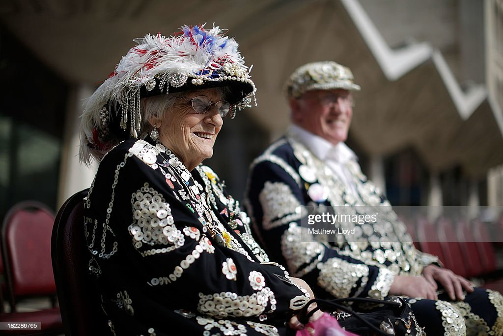 Lily York, The Pearly Queen of Smithfield Market sits as Pearly Kings and Queens gather in the Guildhall Yard on September 29, 2013 in London, England. The Harvest Festival features dancing and entertainment by participants in traditional costumes and concludes with a service at St Mary-le-Bow Church, home of the renowned Bow Bells. Dressing as a Pearly King or Queen, by wearing clothes adorned with pearl buttons, originated in the 19th century when London street sweeper Henry Croft decorated his uniform and began collecting money for charity