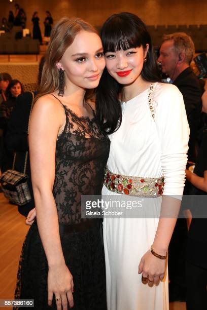 LilyRose Depp and Nana Komatsu after the Chanel 'Trombinoscope' collection Metiers d'Art 2017/18 fashion show at Elbphilharmonie on December 6 2017...