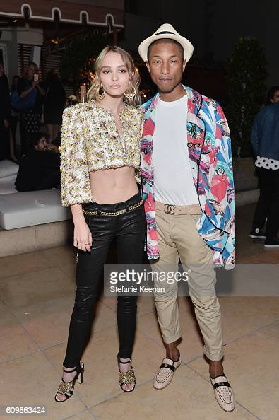 LilyRose Depp and Pharrell Williams both wearing Chanel attend the Chanel dinner celebrating N°5 L'Eau with LilyRose Depp at Sunset Tower Hotel on...
