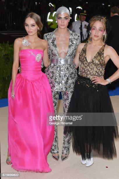 LilyRose Depp Cara Delevingne and Jemima Kirke attend the 'Rei Kawakubo/Comme des Garcons Art Of The InBetween' Costume Institute Gala at...