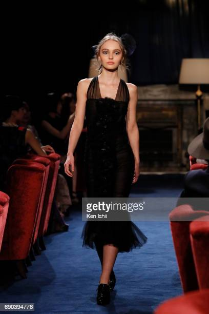 LilyRose Depp showcases designs by CHANEL on the runway during the CHANEL Metiers D'art Collection Paris Cosmopolite show at the Tsunamachi Mitsui...