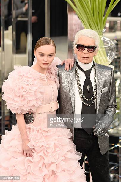LilyRose Melody Depp and Karl Lagerfeld walk the runway during the Chanel Spring Summer 2017 show as part of Paris Fashion Week on January 24 2017 in...
