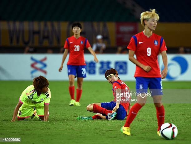 Lim Seonjoo of South Korea looks back after falling down during their women's East Asian Cup football match against Japan at the Wuhan Sports Center...