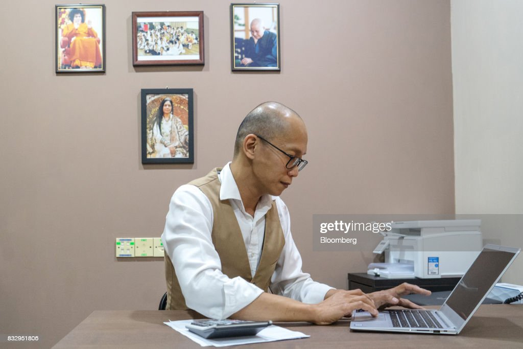 Lim Tze Cheng, chief executive officer of Inter-Pacific Asset Management Sdn., works on his computer in his office in Kuala Lumpur, Malaysia, on Tuesday, Aug. 15, 2017. Lim has been buying Malaysian technology and manufacturing stocks that he thinks will increase profit over the long term, betting that the rally in technology has several years to run. Photographer: Sanjit Das/Bloomberg via Getty Images