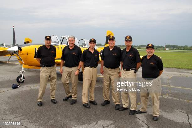 Lima Lima Flight Team members Bill Cherwin Rick Nichols Mark Miller Ed Hicks Skip Aldous and John Rippinger poses for photos at the Gary Jet Center...