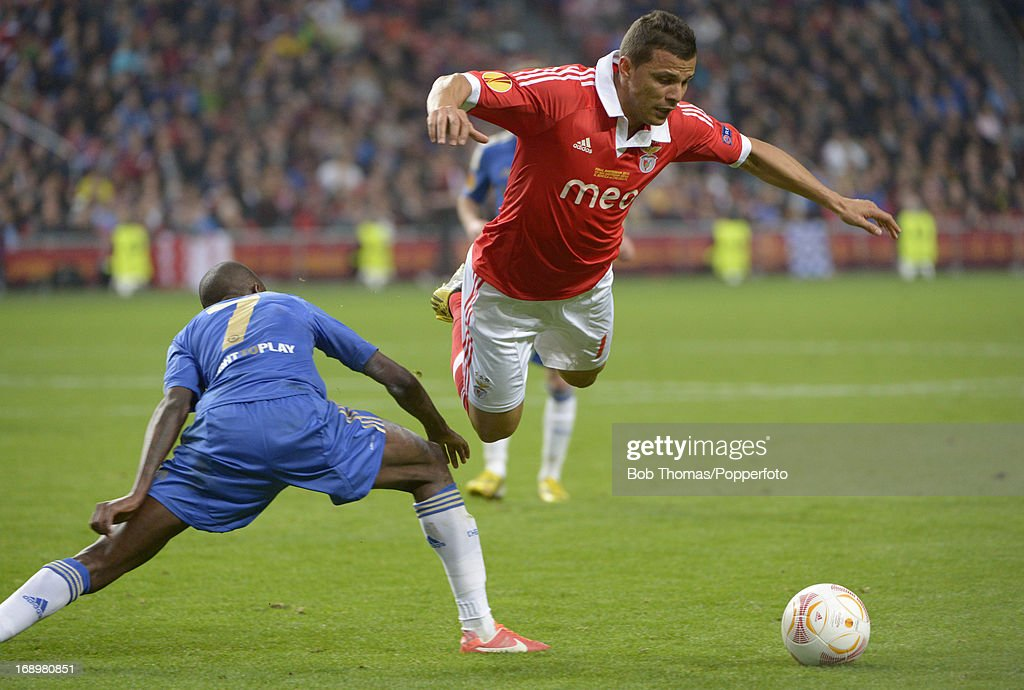 Lima of Benfica in midair after a challenge from Ramires of Chelsea during the UEFA Europa League Final between SL Benfica and Chelsea FC at the Amsterdam Arena on May 15th, 2013 in Amsterdam, Netherlands. Chelsea won the match 2-1.
