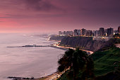 High angle view of the city coastline at dusk in Lima, Peru.