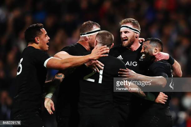 Lima Sopoaga celebrates with Anton LienertBrown TJ Perenara Kieran Read and Wyatt Crockett of the All Blacks after scoring a try during the Rugby...