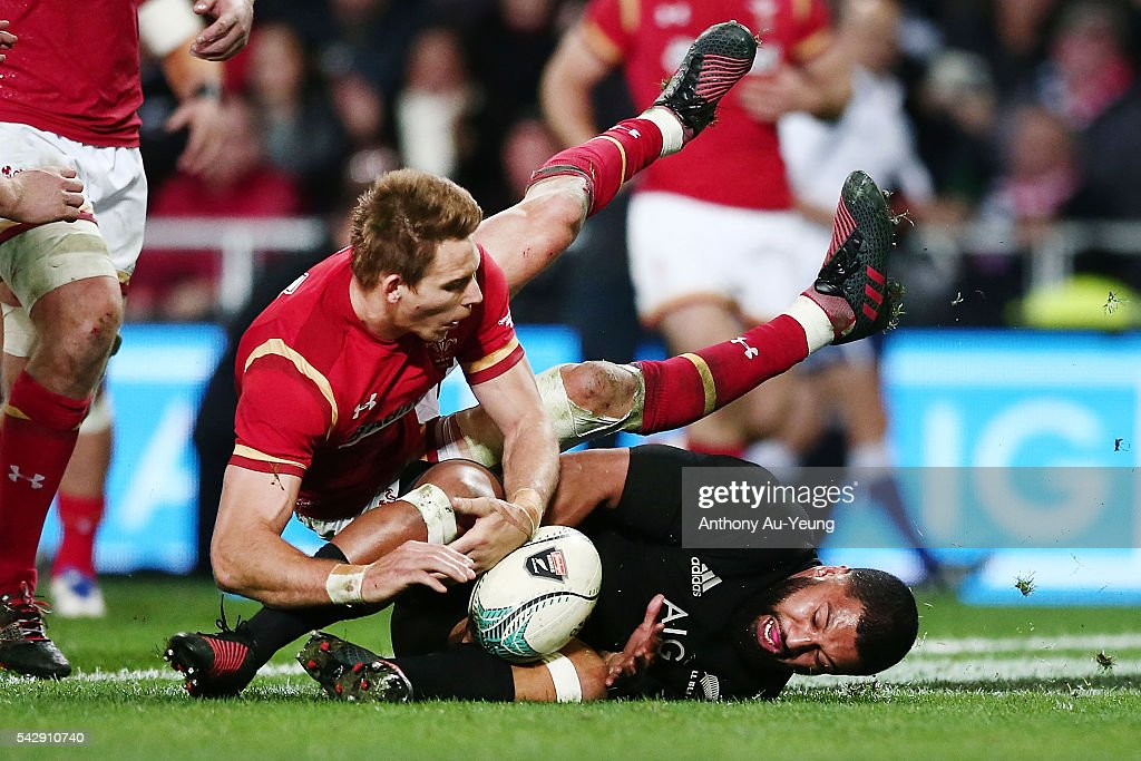 Lima Sopoaga of New Zealand clashes with Liam Williams of Wales going after a try during the International Test match between the New Zealand All Blacks and Wales at Forsyth Barr Stadium on June 25, 2016 in Dunedin, New Zealand.