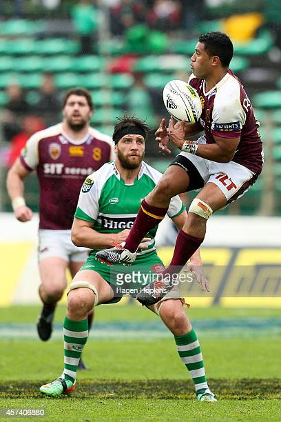 Lima Sopoaga of Southland takes a high bal while Heiden BedwellCurtis of Manawatu looks on during the ITM Cup Championship Semi Final match between...