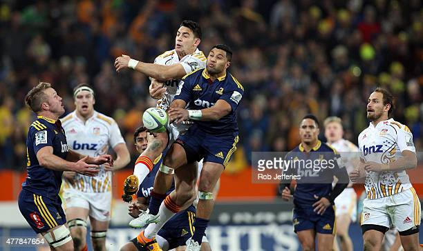 Lima Sopoaga of the Highlanders and Bryce Heem of the Chiefs compete for the ball during the Super Rugby Qualifying Final match between the...