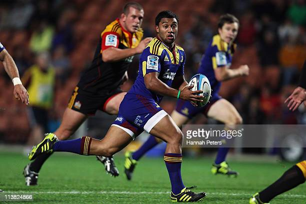 Lima Sopoaga of the Highlanders makes a break during the round 12 Super Rugby match between the Chiefs and the Highlanders at Waikato Stadium on May...
