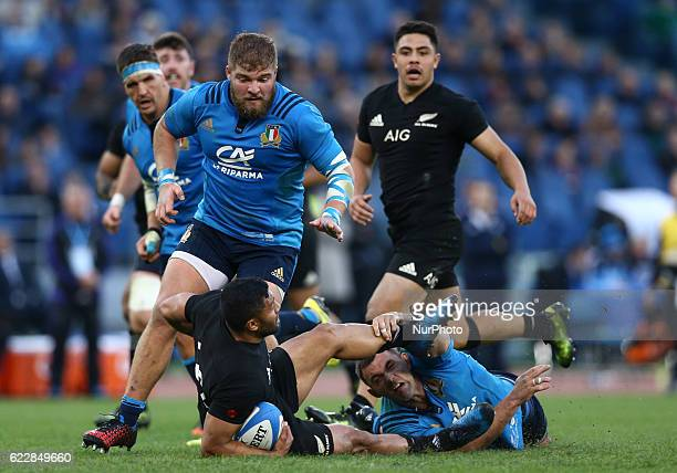 Lima Sopoaga of the New Zealand All Blacks tackled by Andries Van Schalkwyk of the Italy Rugby during the international rugby match between New...