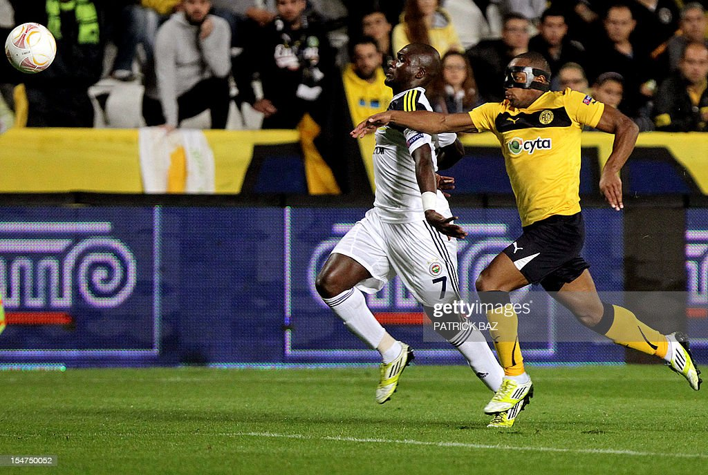 AEL Limassol's defender Carlitos challenges Fenerbahce's forward Moussa Sow (L) during the UEFA Europa League group C football match between AEL Limassol and Fenerbahce at GSP Stadium in the Cypriot capital Nicosia on October 25, 2012.