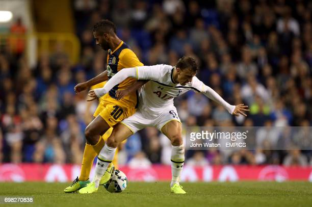 AEL Limassol's Diego Barcelos and Tottenham Hotspur's Vlad Chiriches battle for the ball