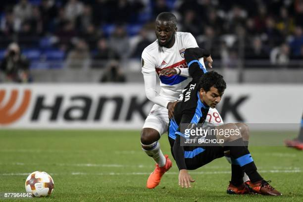 Limassol's Italian forward Emilio Zelaya vies with Lyon's French midfielder Tanguy NDombele during the UEFA Europa League football match Olympique...