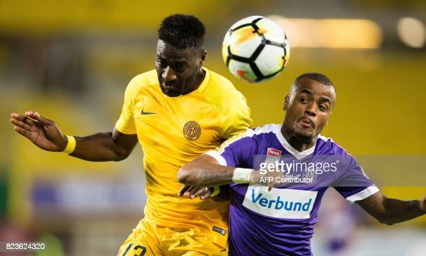 Limassol's Kevin Lafrance jumps for the ball with Austria Wien's Felipe Pires during a UEFA Europa League qualifying football match between FK...