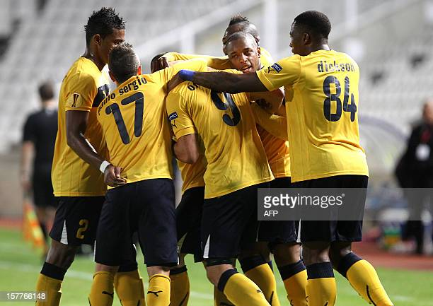 AEL Limassol's players celebrate after scoring a goal against Marseille during their UEFA Europa League group C football match at GSP Stadium in the...