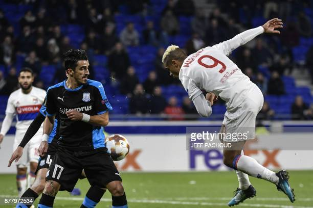 Limassol's Portuguese midfielder Joao Pedro vies with Lyon's Spanish forward Mariano Diaz during the UEFA Europa League football match Olympique...
