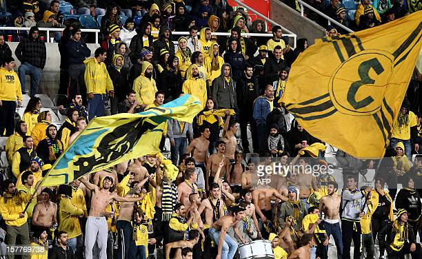 AEL Limassol's supporters celebrate after their team scored a goal against Marseille during their UEFA Europa League group C football match at GSP...