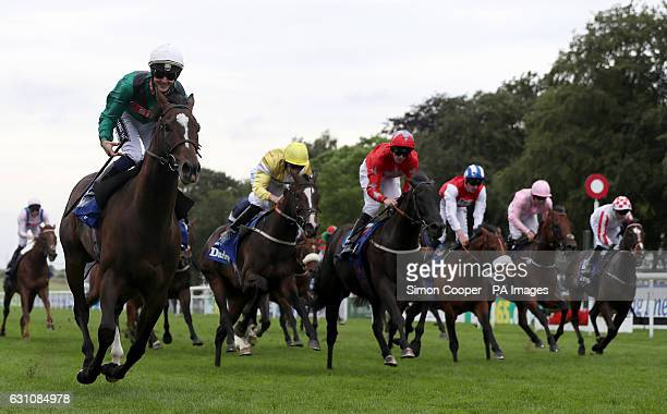 Limato ridden by Harry Bentley wins The Darley July Cup during the Darley July Cup Day of The Moet Chandon July Festival at Newmarket Racecourse