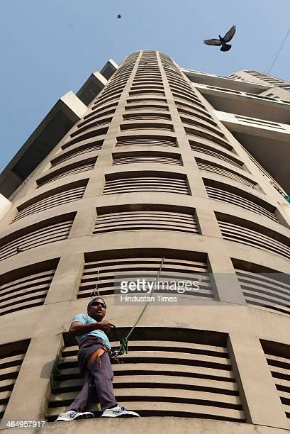 Limca Book record holder Gaurav Sharma hones his skills as he prepares to climb the 40storey Shreepati Jewels building at Girgaum ahead of the...