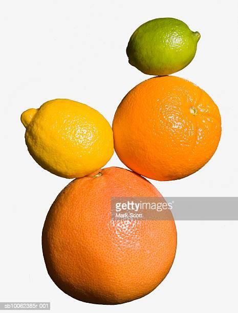 Lime, lemon, orange and grapefruit on white background