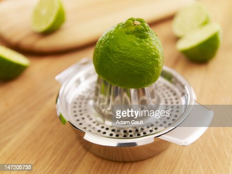 Lime on juicer : Stock Photo