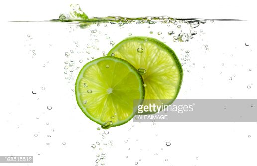 Lime slices splashing in fresh water