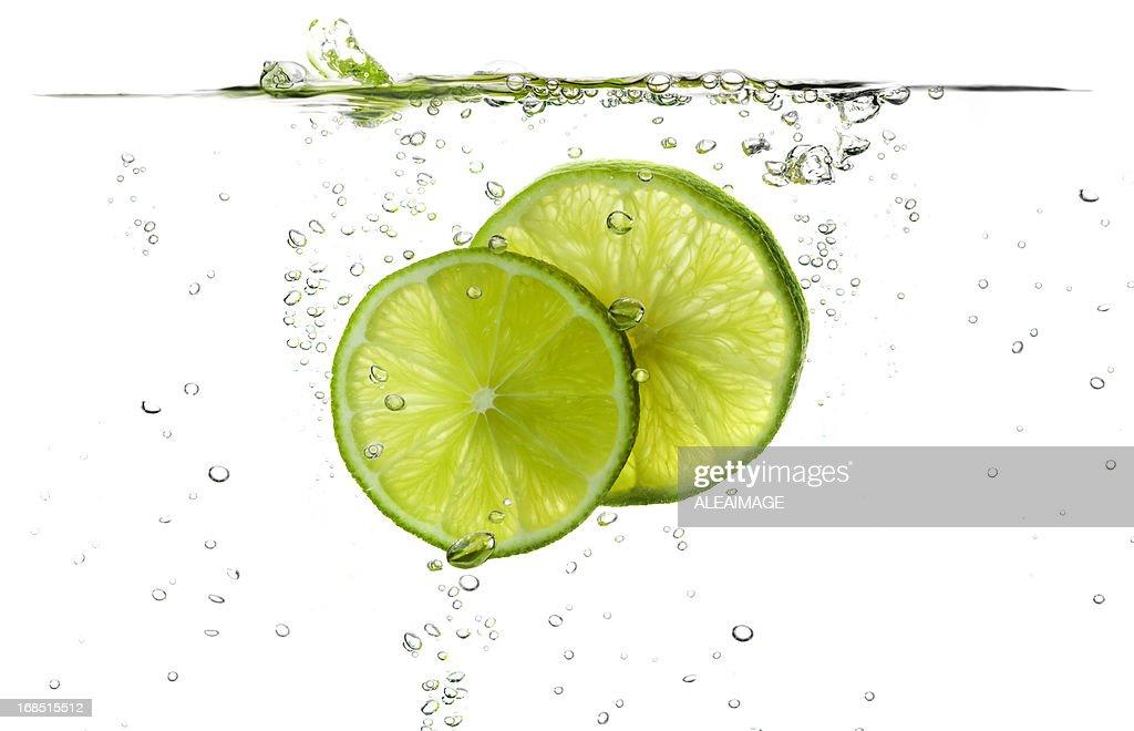 splash lemon slice under the water macro photo art