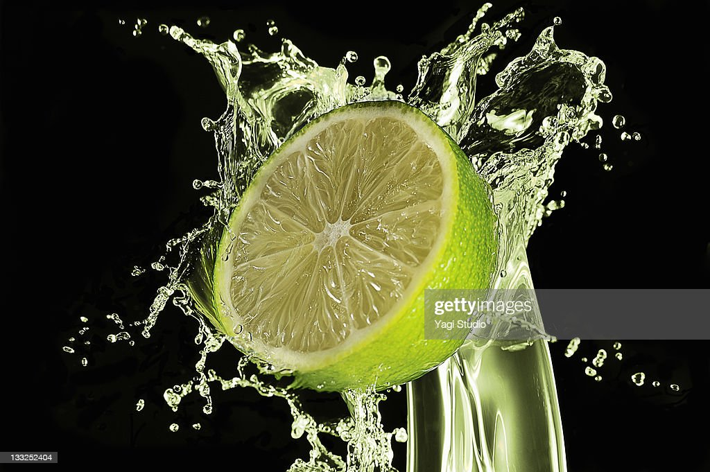 Lime splash by juice, close-up. : Stock Photo