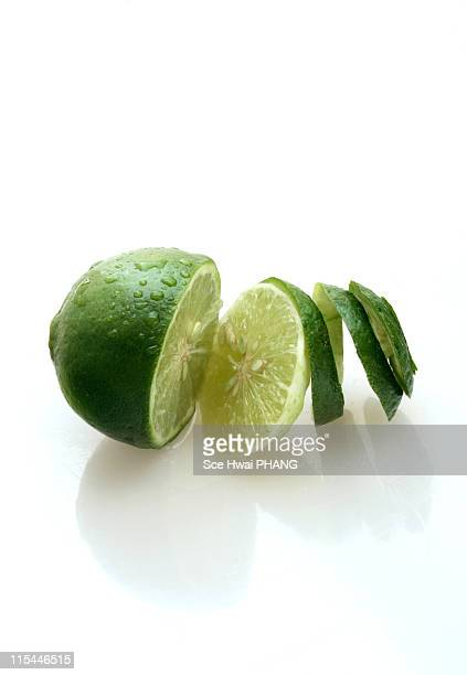 Lime with spiral skin on white background