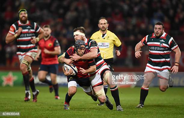 Limerick Ireland 10 December 2016 Duncan Williams of Munster is tackled by Brendon O'Connor of Leicester Tigers during the European Rugby Champions...