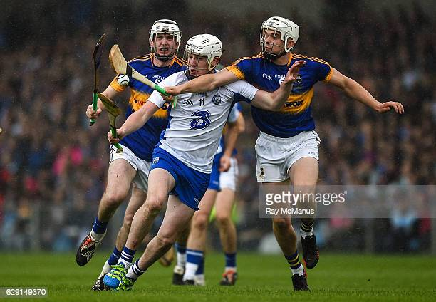 Limerick Ireland 10 July 2016 Ronan Maher of Tipperary supported by Seamus Kennedy vies for possession of the sliothar with Shane Bennett of...