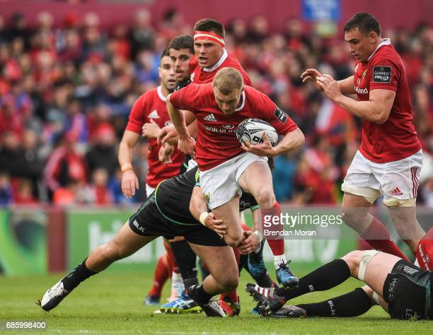 Limerick Ireland 20 May 2017 Keith Earls of Munster is tackled by Scott Baldwin of Ospreys during the Guinness PRO12 semifinal match between Munster...