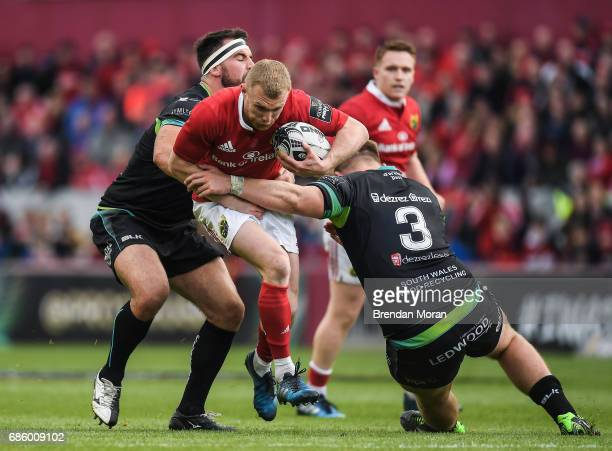 Limerick Ireland 20 May 2017 Keith Earls of Munster is tackled by Scott Baldwin left and Rhodri Jones of Ospreys during the Guinness PRO12 semifinal...