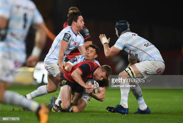 Limerick Ireland 21 October 2017 Keith Earls of Munster is tackled by Dan Carter and Henry Chavancy of Racing 92 during the European Rugby Champions...